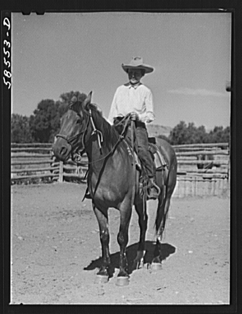 Marion Post Wolcott: Mrs. Lyman Brewster on one of their ranch horses in the corral. Quarter Circle U, Brewster-Arnold Ranch Company. Birney, Montana
